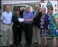 RLA chairman presents Dan Garung with our cheque in support of their proposed memorial.